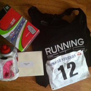 Singlet, bib, and prizes.