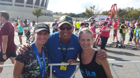 Megan and I with our awesome Coach Frostick! He and his wife, Amy, and team (J&A Racing) host the best races down to every little last detail.